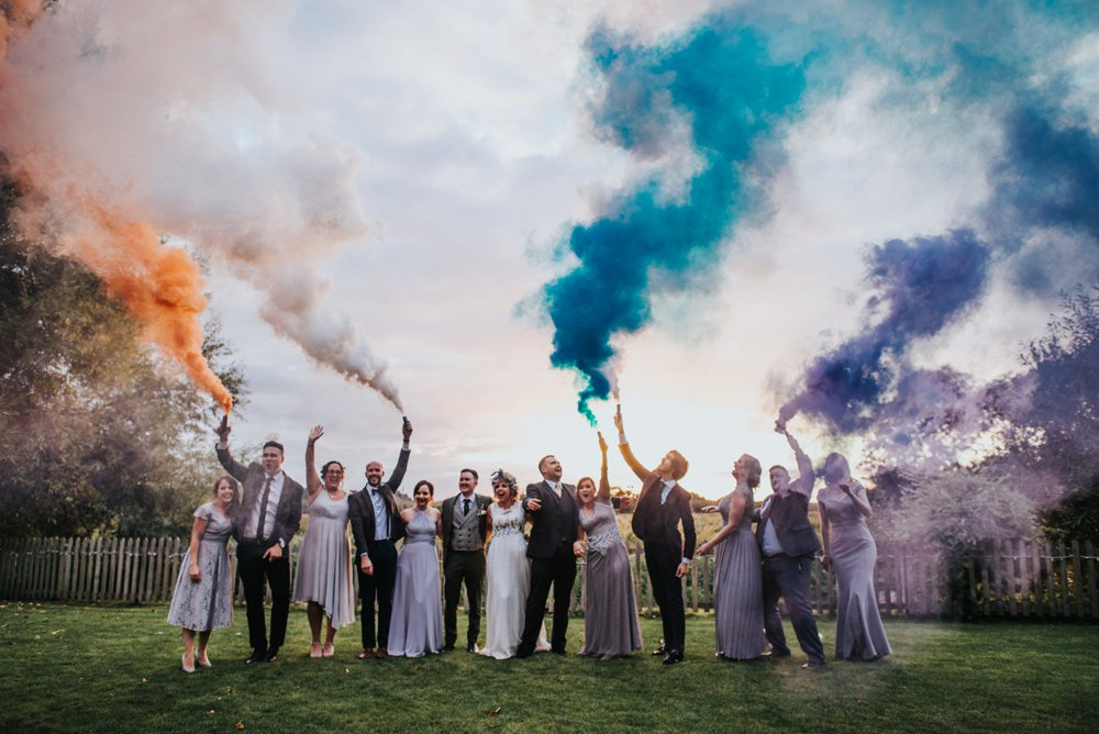 wedding party holding smoke bombs at sopley mill