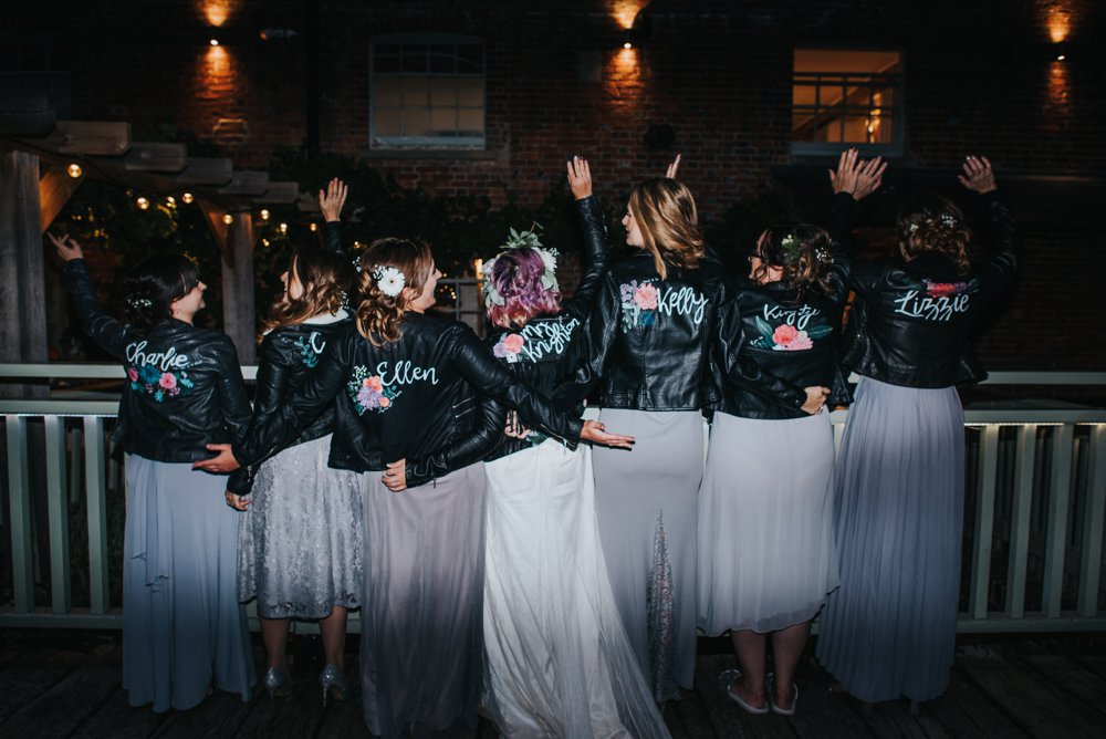 bride and bridesmaids wearing hand designed leather jackets