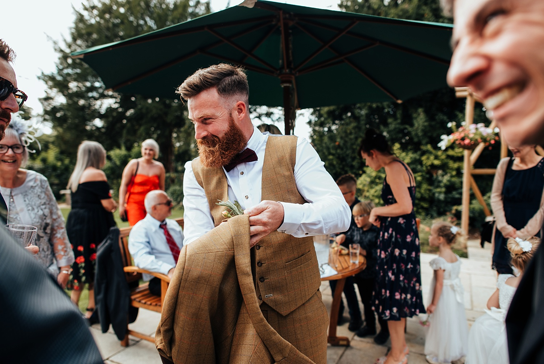 groom with long beard wearing tweed dress2kill suit