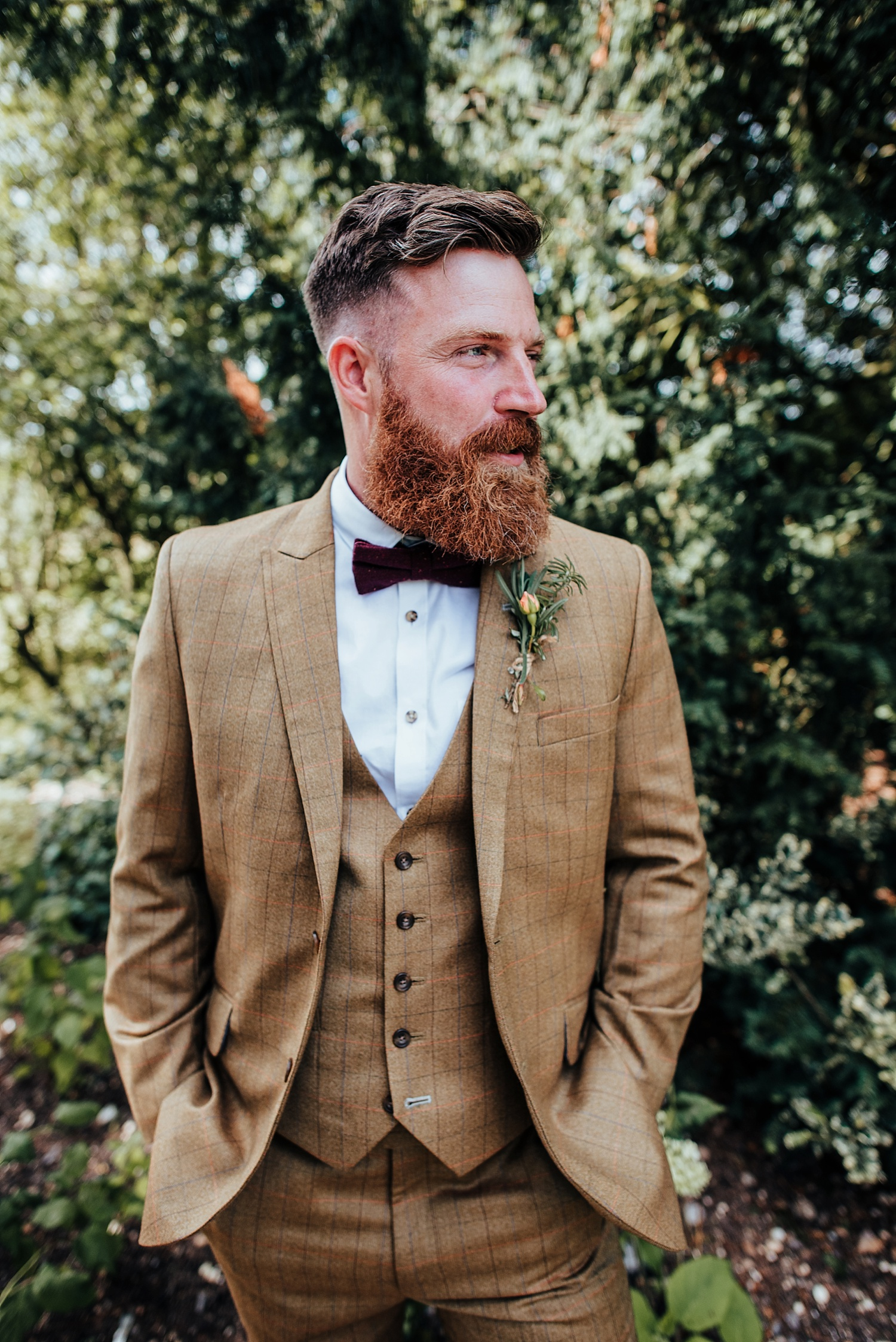 groom with long beard wearing brown tweed dress2kill suit and bowtie