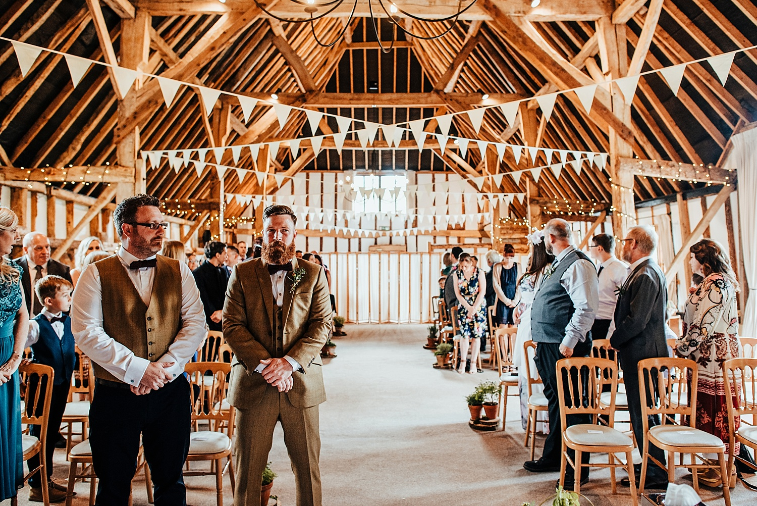 groom and best man waiting for bride to arrive at clock barn