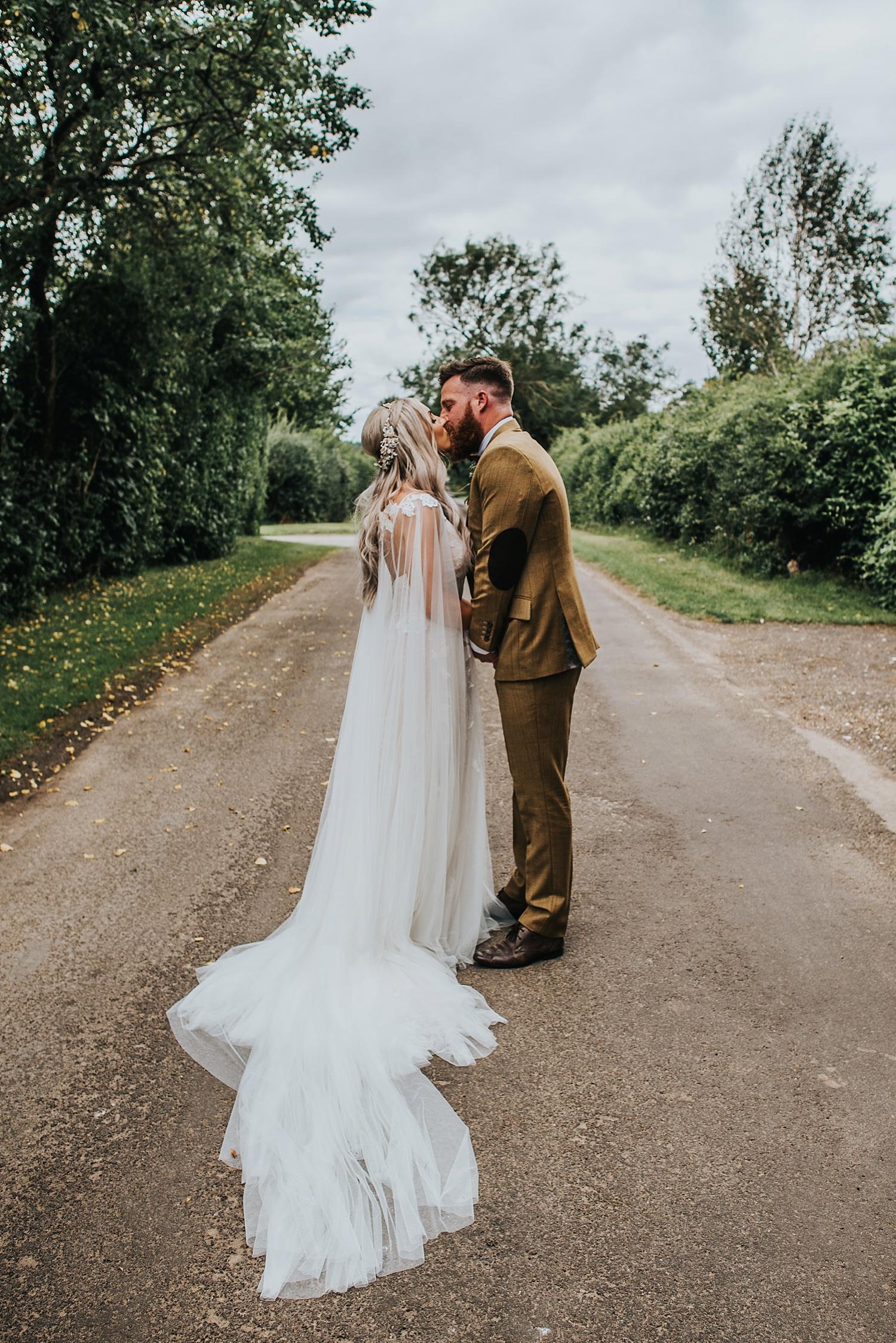 bride and groom walking through confetti at clock barn