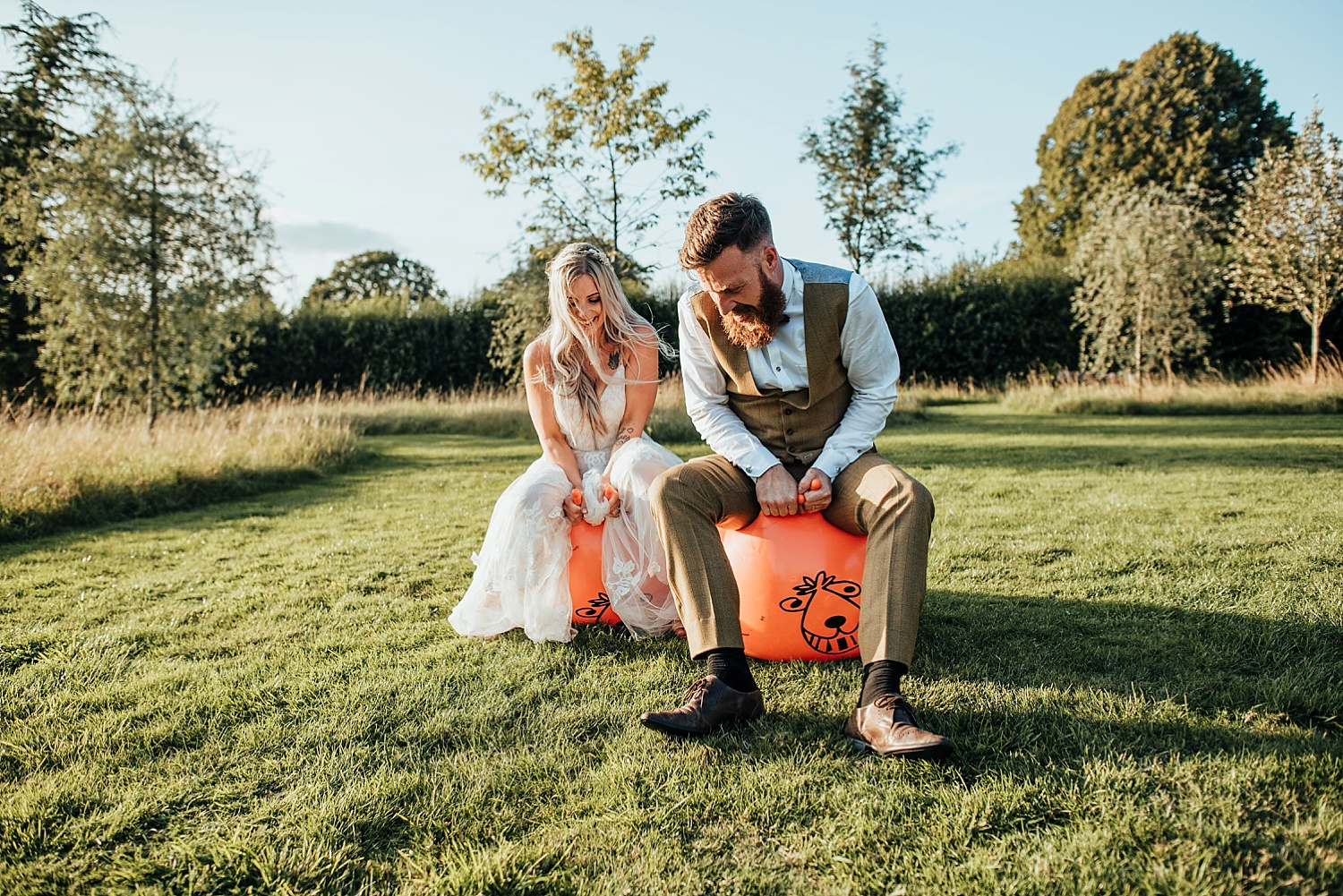 bride and groom falling off orange space hoppers