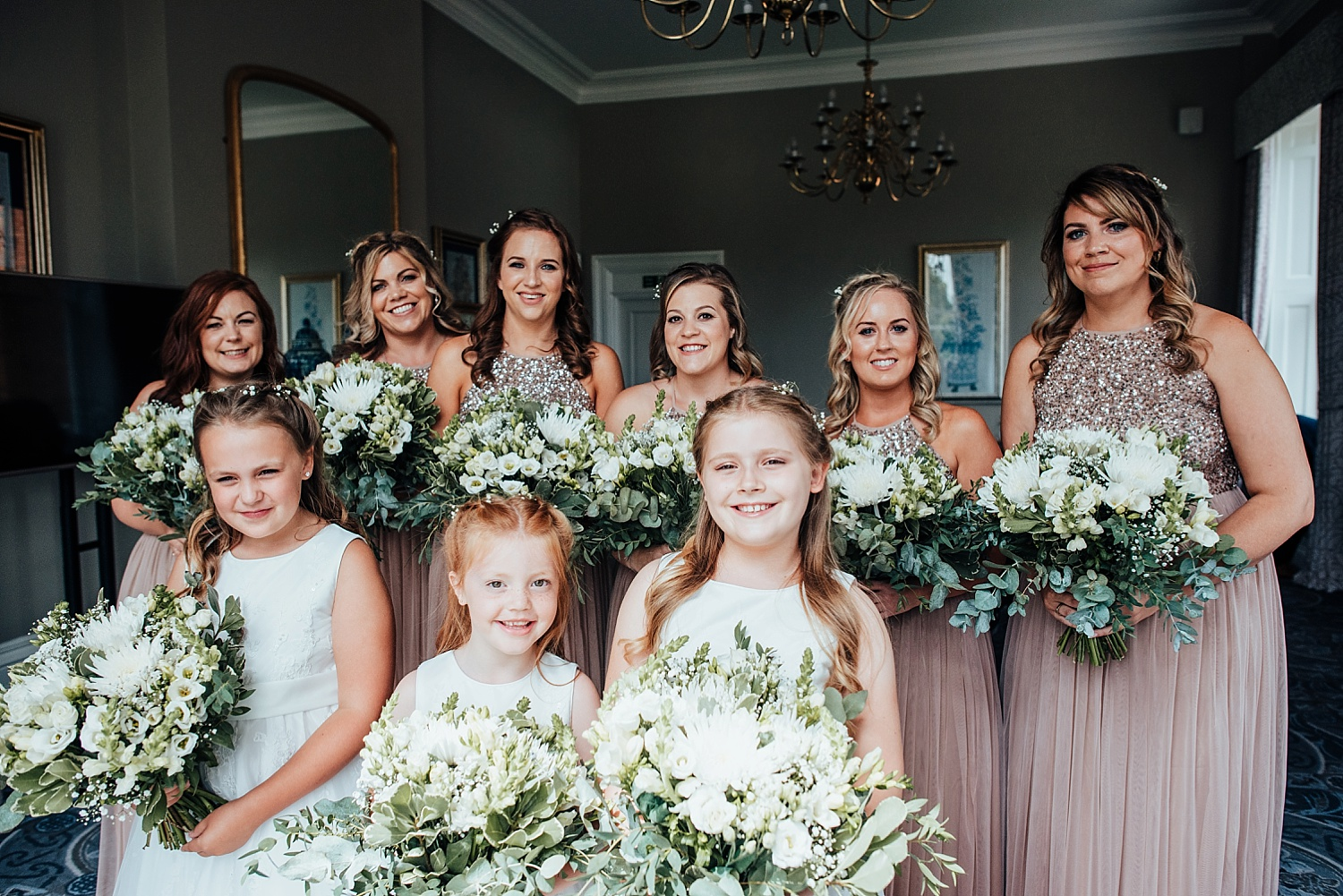 bridesmaids in blush dresses oakley hall wedding