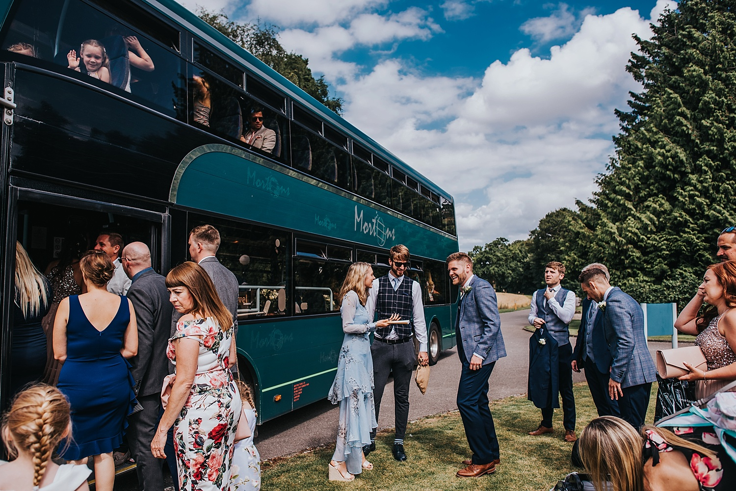 weddings guests boarding wedding bus to bombay sapphire