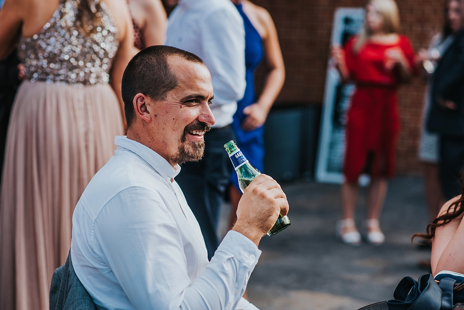 man drinking beer bombay sapphire distillery wedding laverstoke