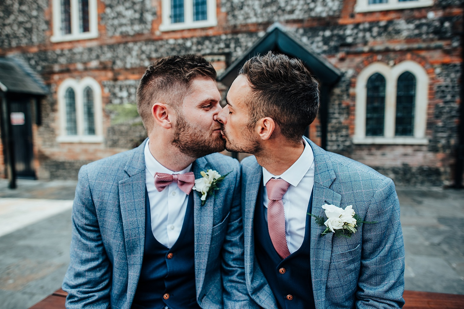 two men kissing at wedding at bombay sapphire distillery wedding laverstoke