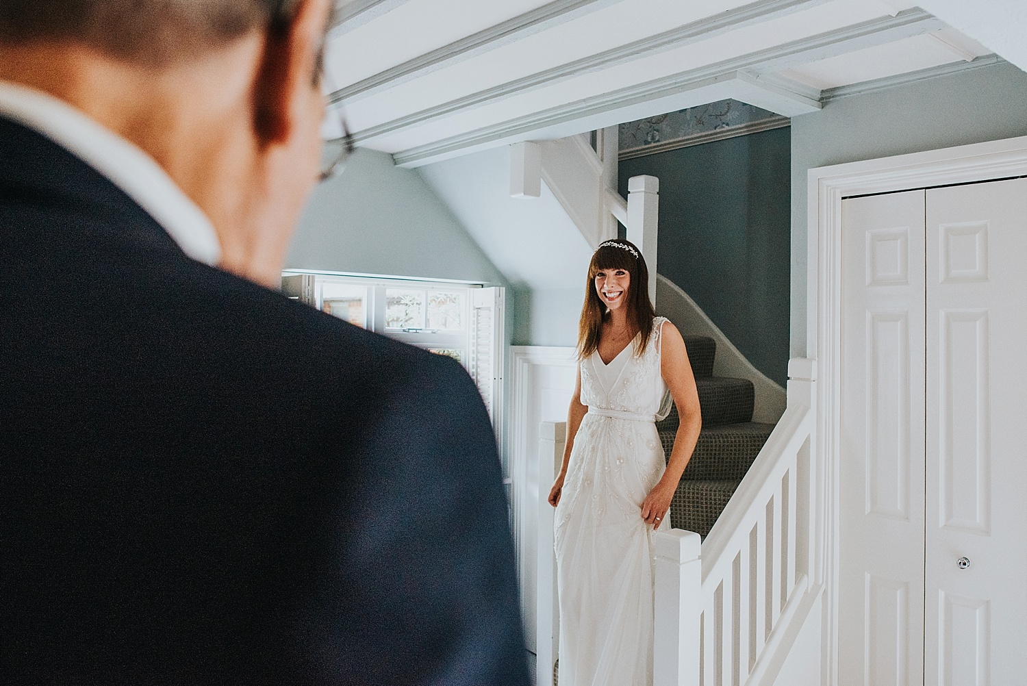 bride walking down the stairs to see her grandfather