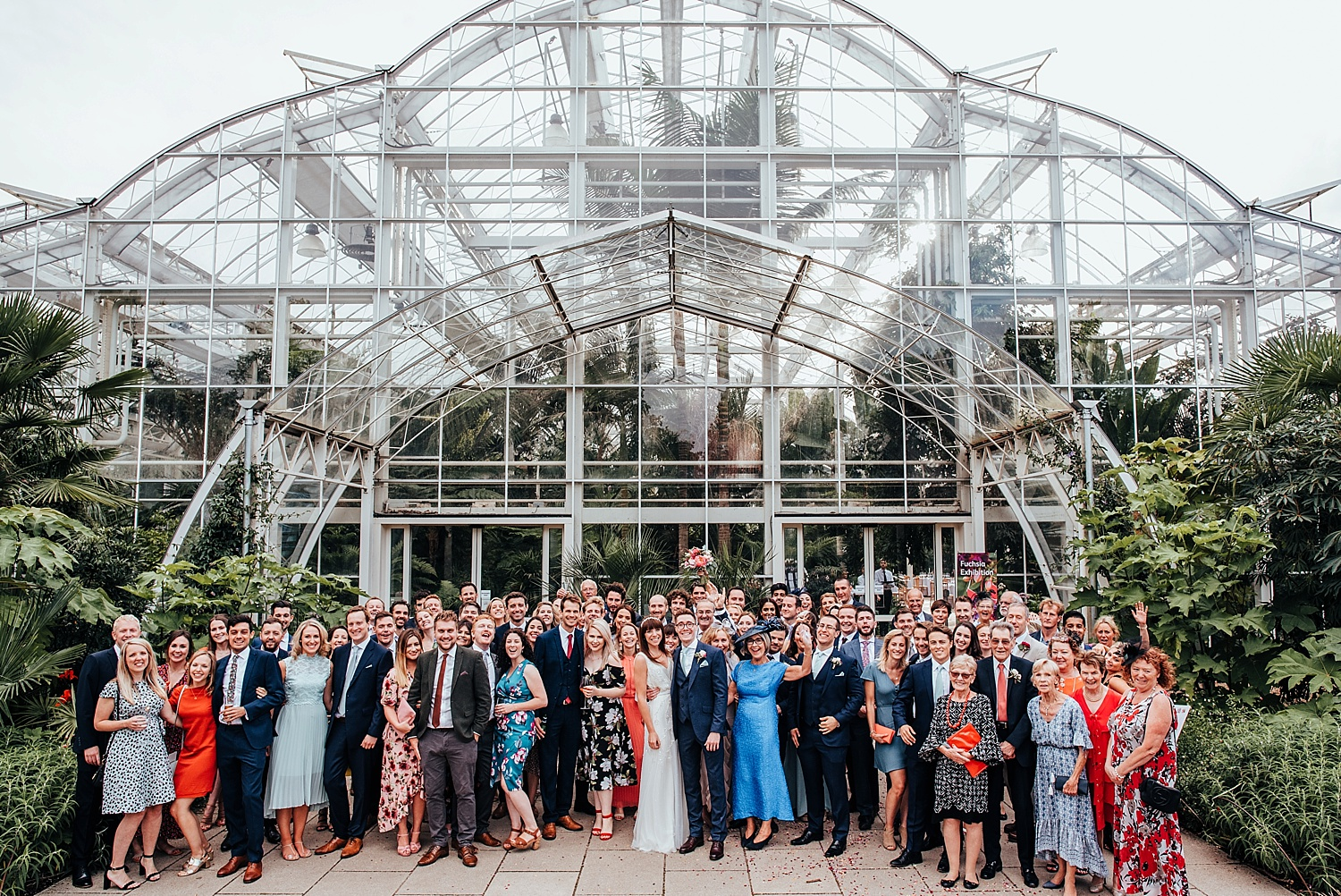 wedding group shot outside RHS Wisley glasshouse