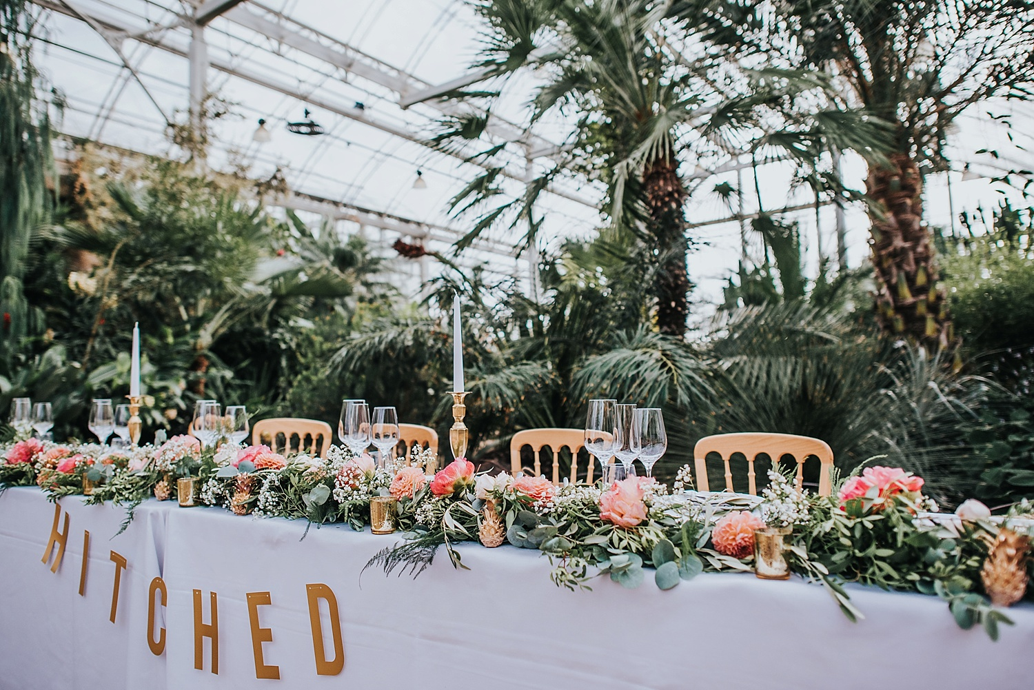 top table wedding setup inside RHS Wisely tropical glasshouse