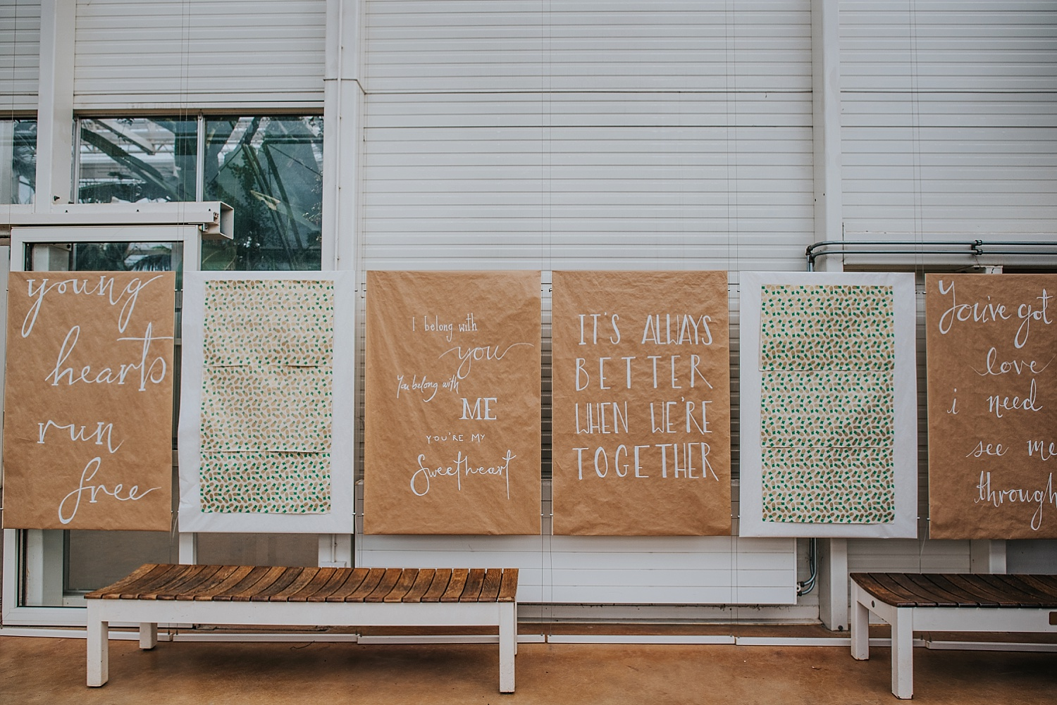 wedding details and signs inside RHS wisley glass house