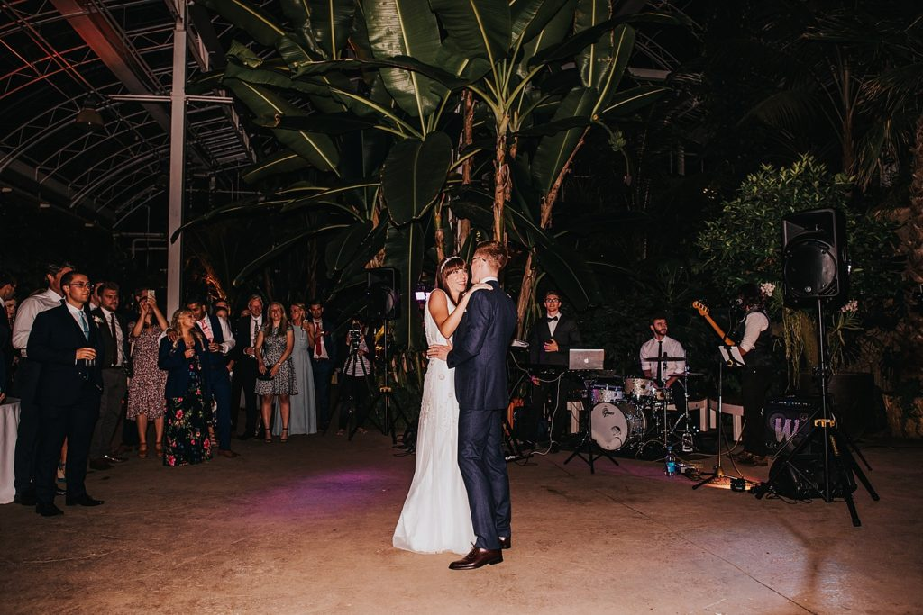 bride and groom first dance inside RHS wisley glasshouse