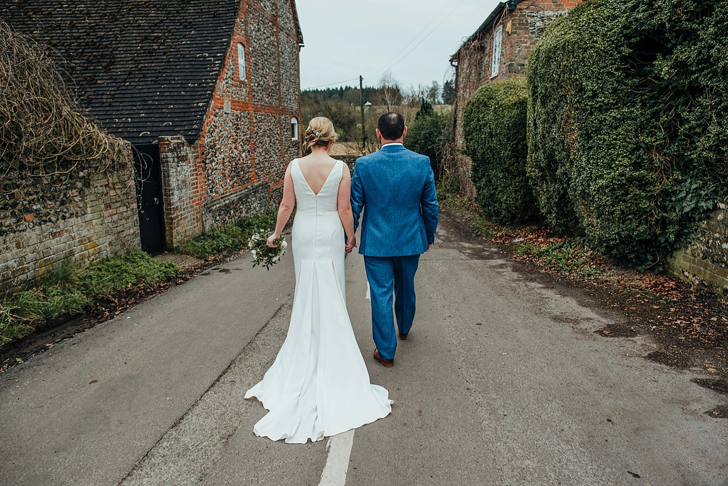 bride and groom walking at Bombay Sapphire Wedding