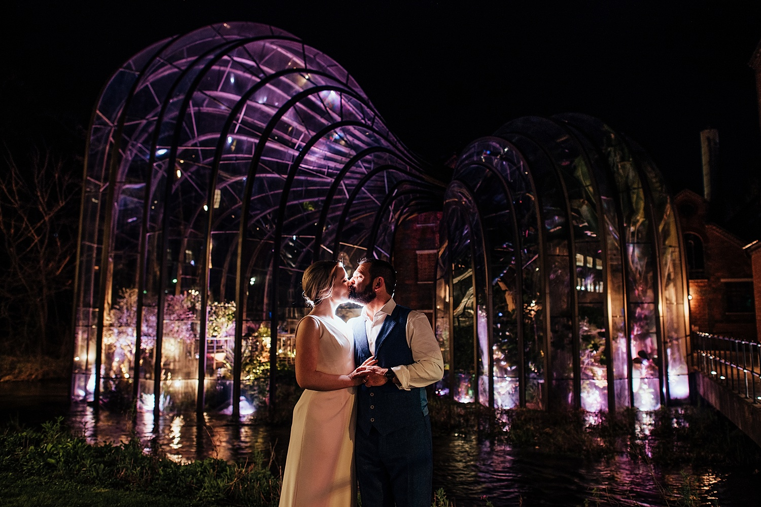 bride and groom standing outside the Mediterranean Glasshouse Bombay Sapphire Wedding