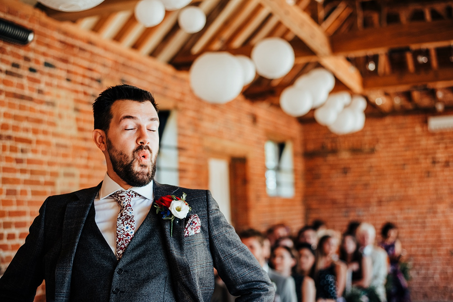 grooms face before bride walks down aisle at stanlake park