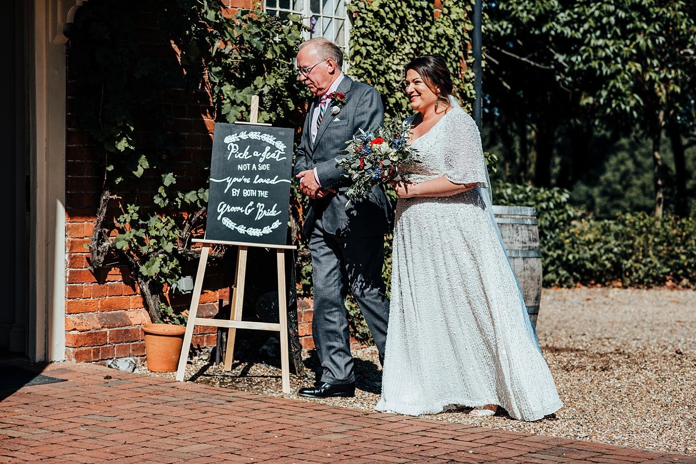 brides walking into barn at Stanlake Park