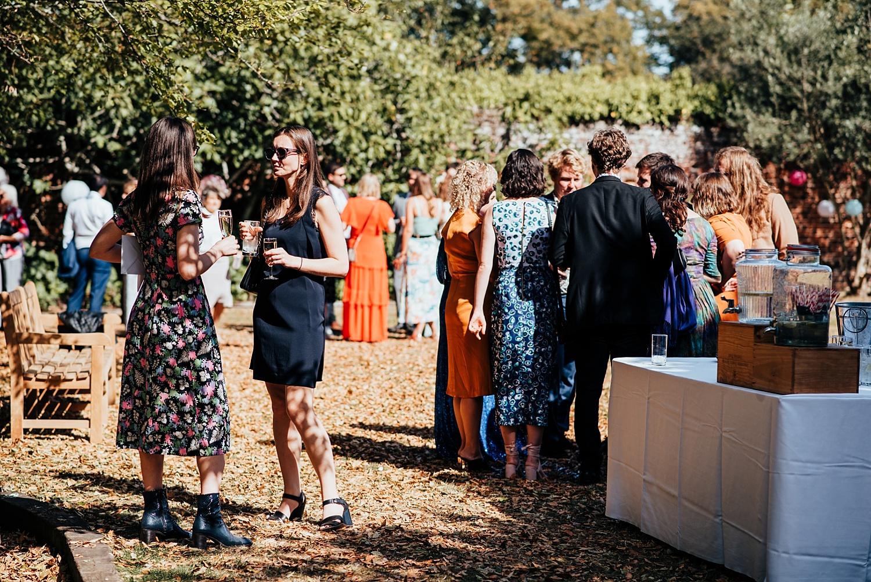 wedding guests talking at Stanlake Park