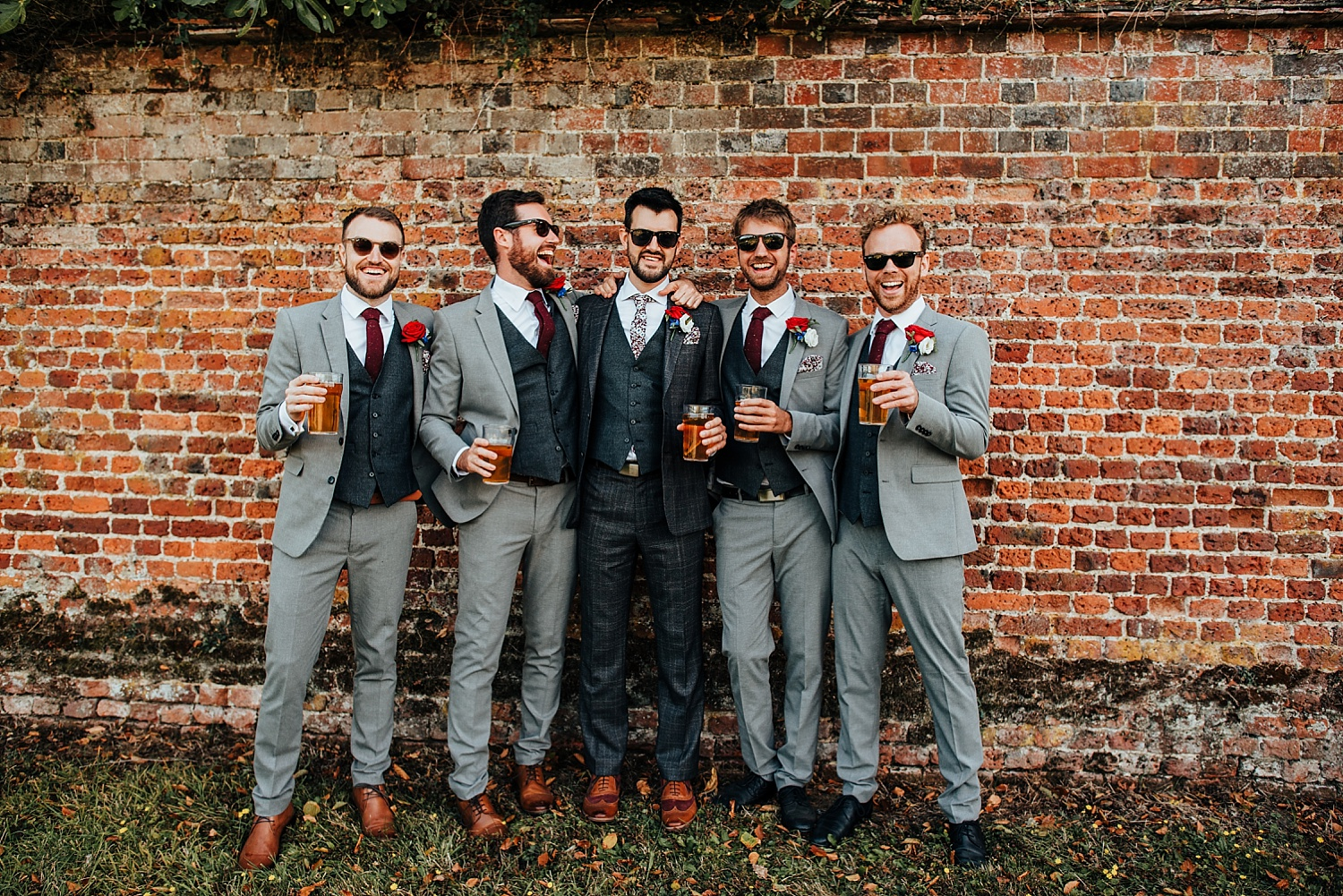 groom and ushers holding a beer at Stanlake Park