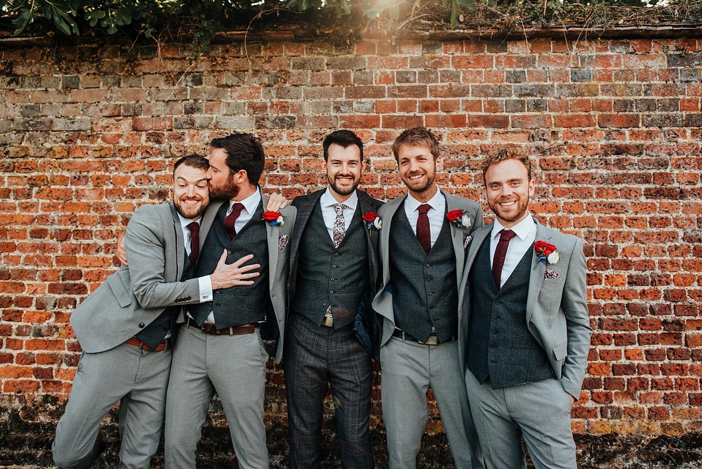 boys hugging at wedding Stanlake Park
