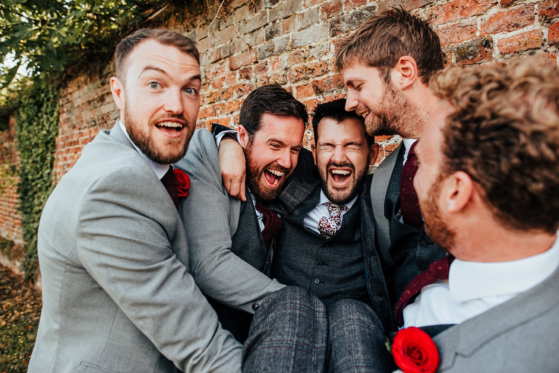 boys picking groom up at Stanlake Park