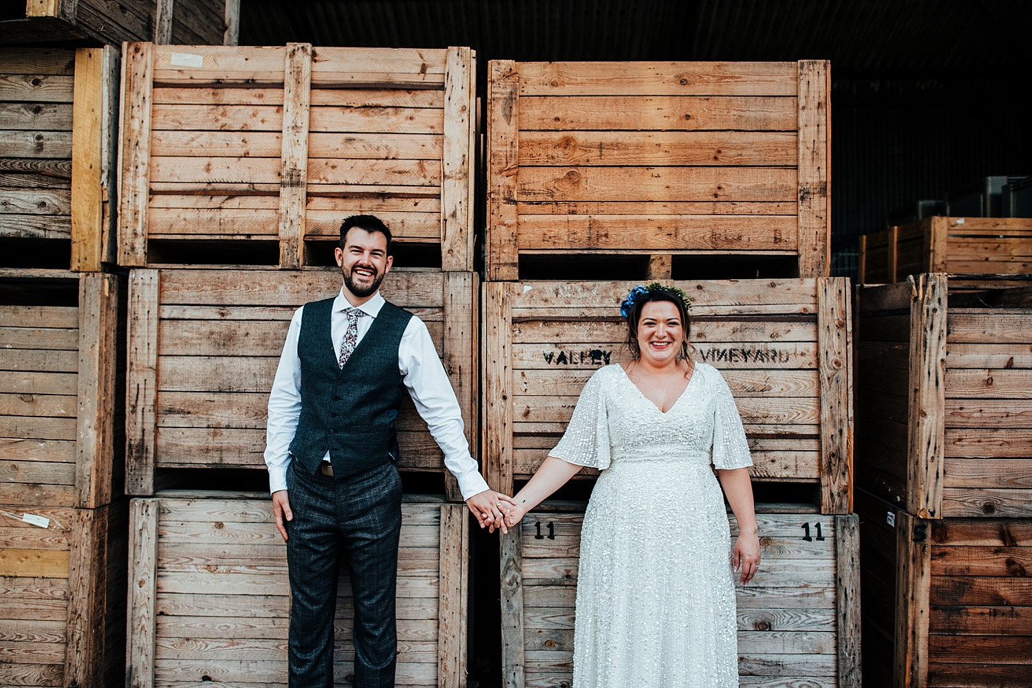 bride and groom standing by wine boxes Stanlake Park