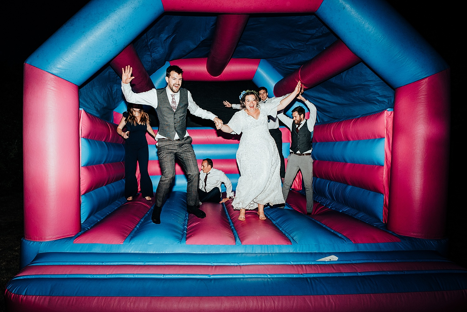bride and groom on bouncy castle Stanlake Park