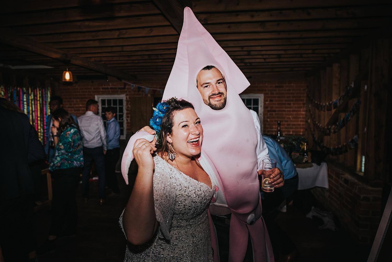 Bride and Groom dressed as squid at Stanlake Park