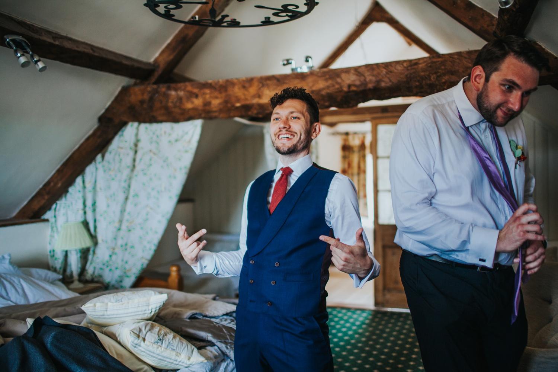 Groom dressed at Huntstile Organic Farm Wedding