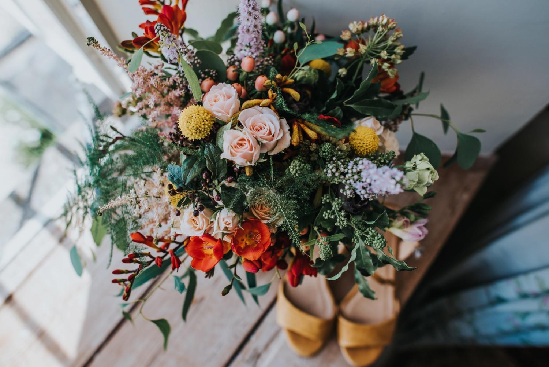 stunning colourful wild flower wedding bouquet