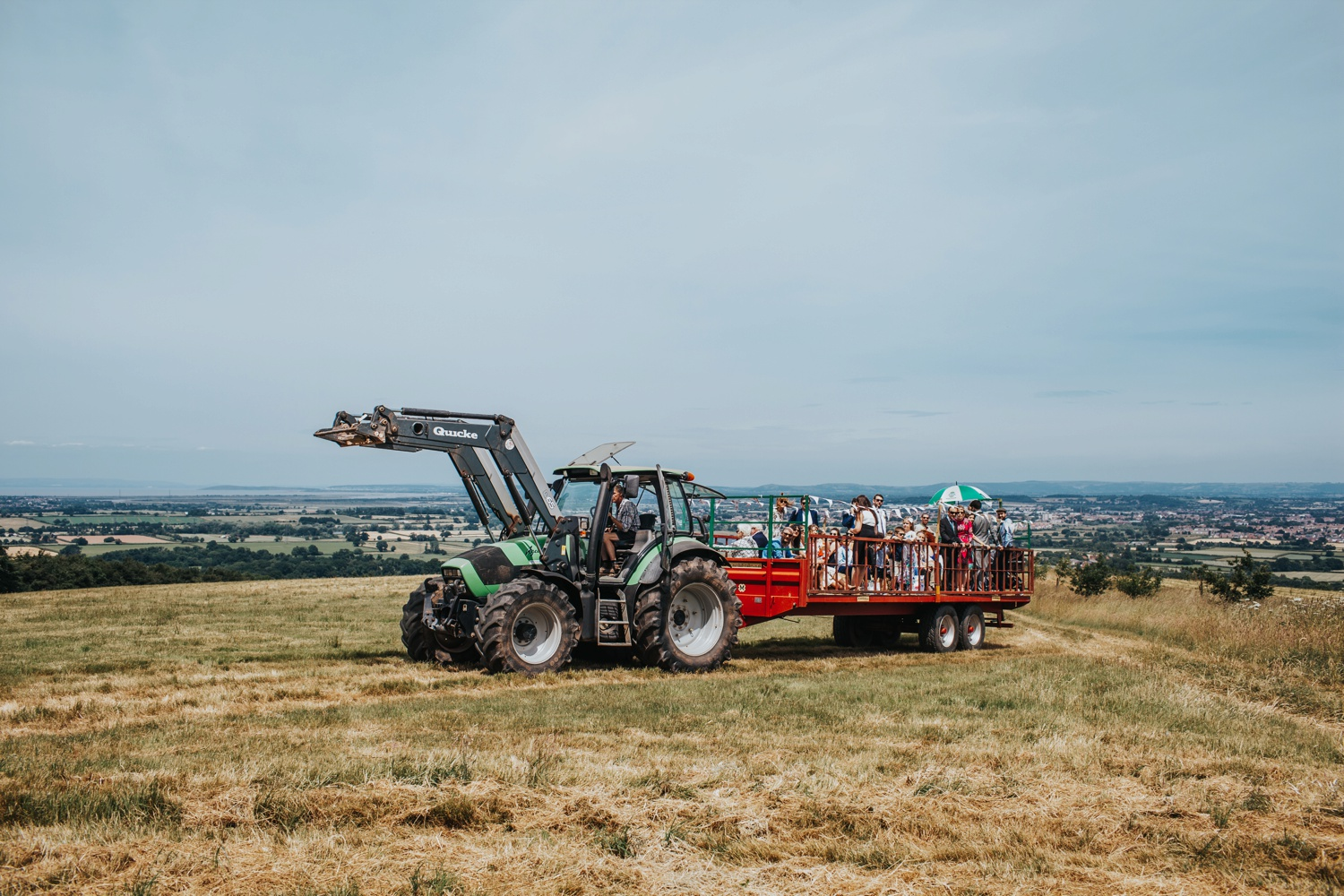 guests riding tractor to stone circle at huntstile farm
