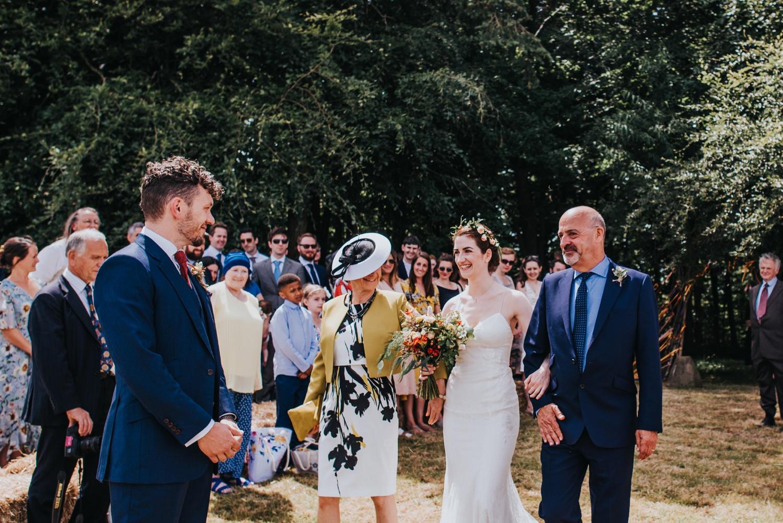 bride walking into stone cirlce huntstile farm