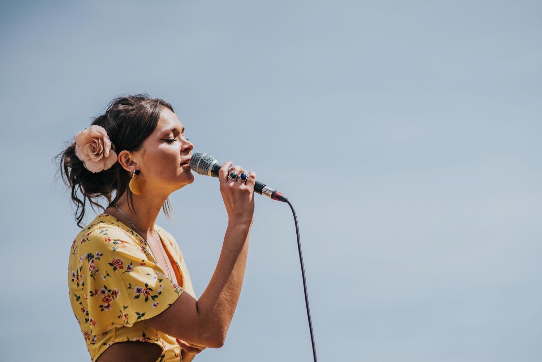 girl singing in yellow dress