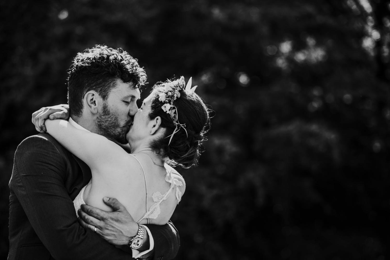 bride and groom kissing, humanist ceremony at stone circle , huntstile farm