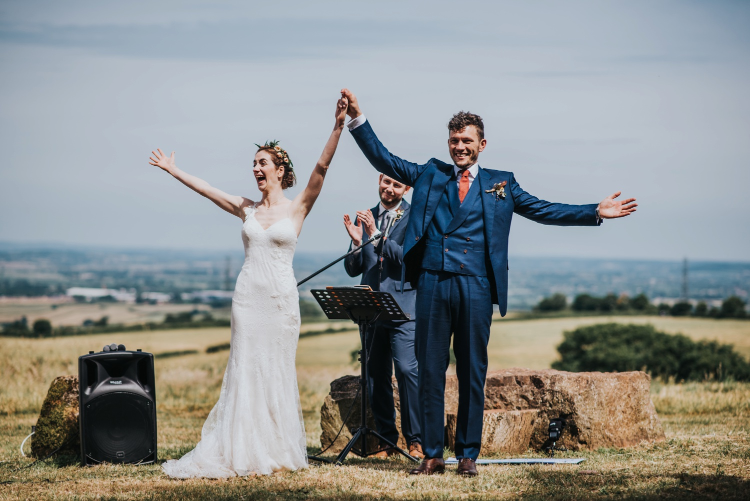 bride and groom hands in the air, humanist ceremony at stone circle , huntstile farm