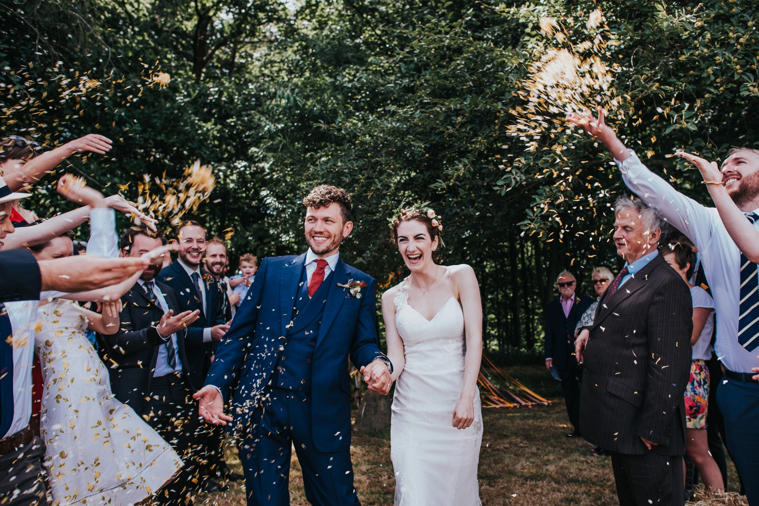 bride and groom walking in confetti, humanist ceremony at stone circle , huntstile farm