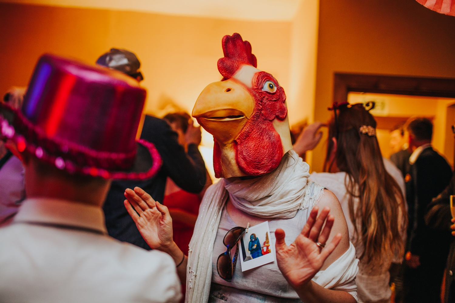 woman dancing with chicken head