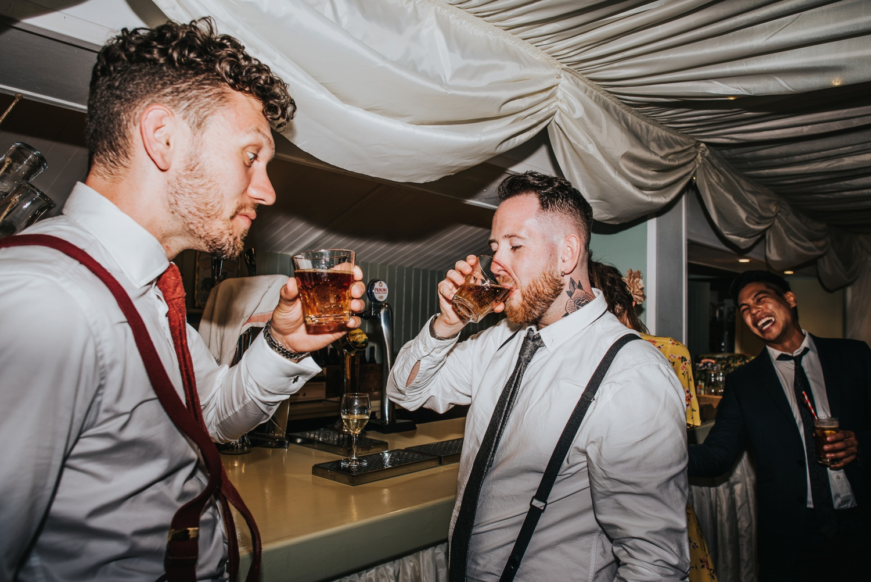 men at bar doing shots at huntstile organic farm