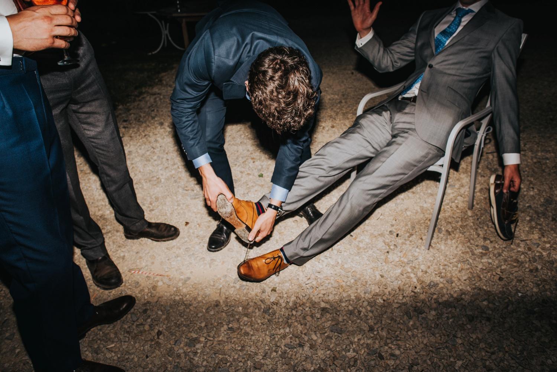 man having shoes taken off