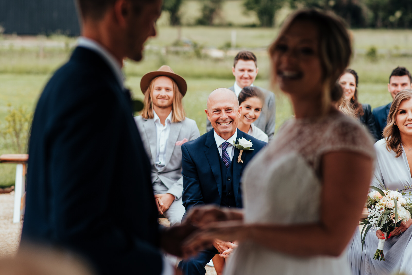 dad smiling as daughter says vows, silchester farm wedding