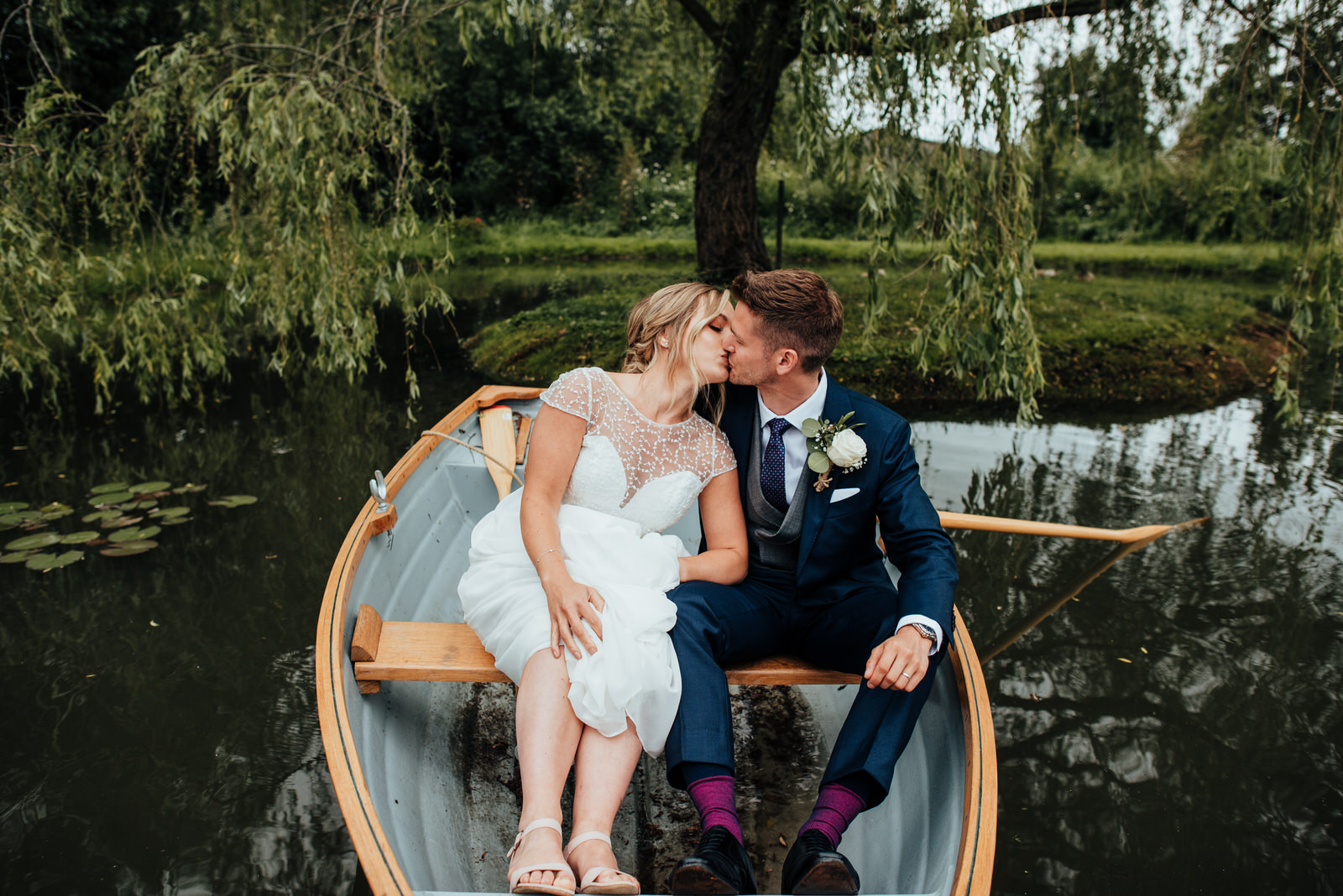 Bride and Groom by lake at Silchester Farm