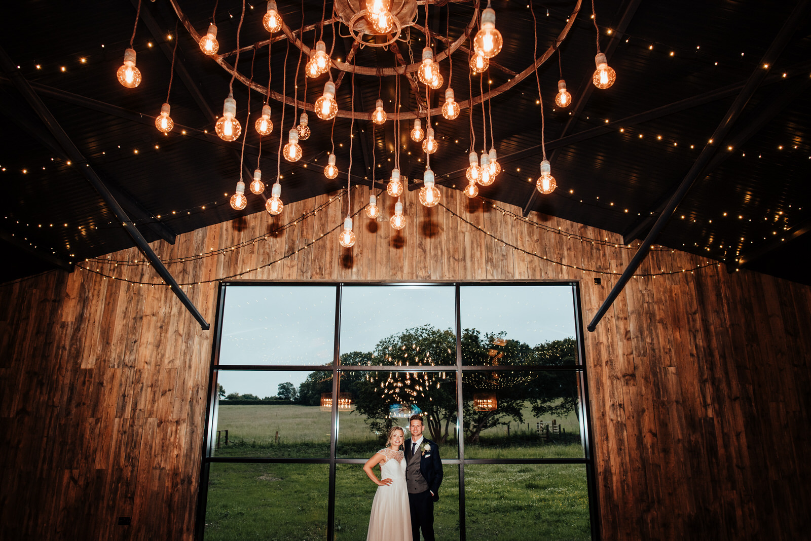 Bride and Groom in The Cow Shed at Silchester Farm