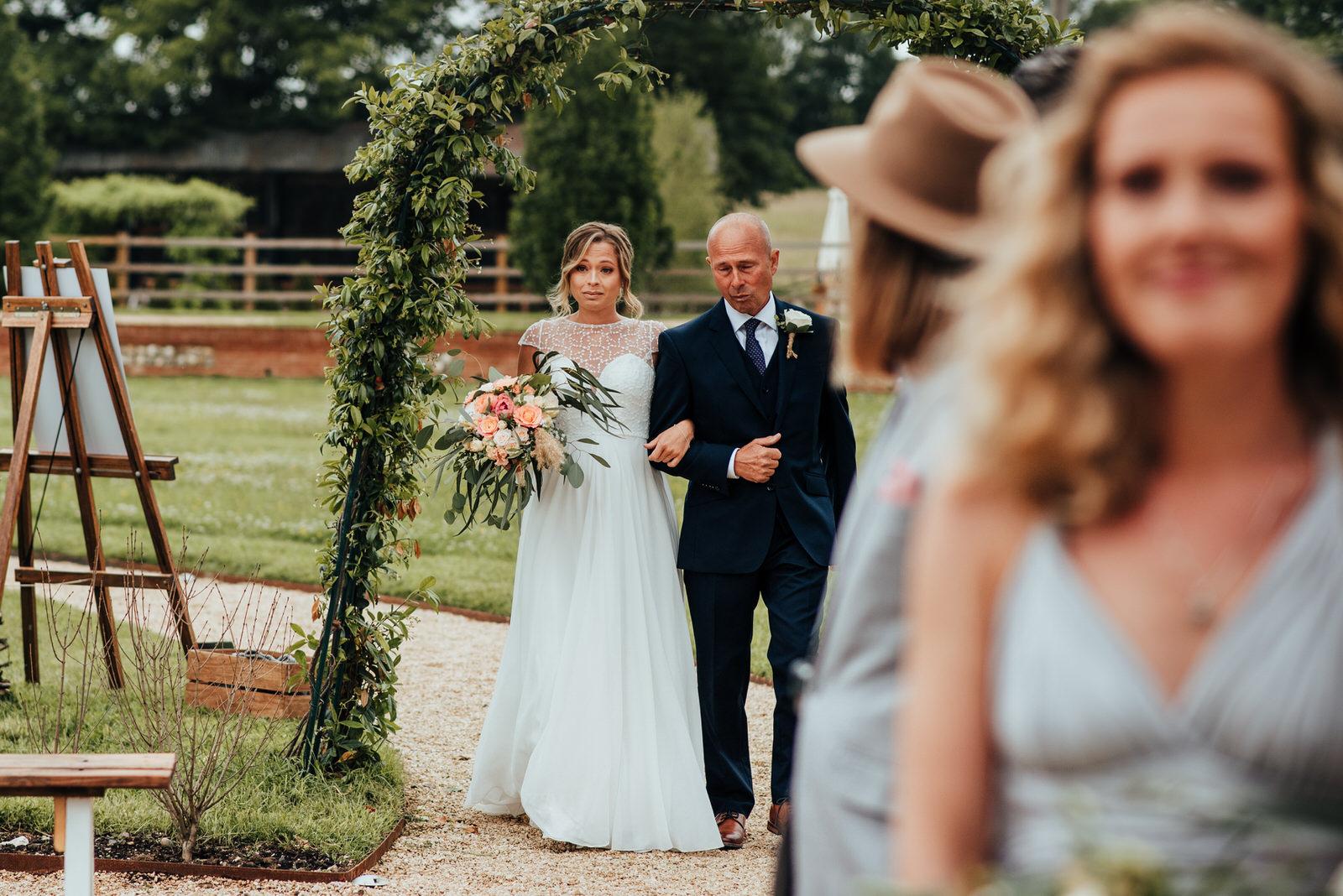 bride walking down isle, silchester farm